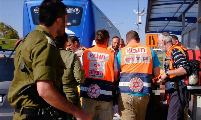 Treating terror victim at Gush Etzion Junction, this afternoon